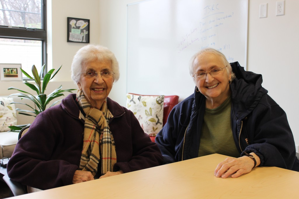 Dorothy and Theresa smiling at table